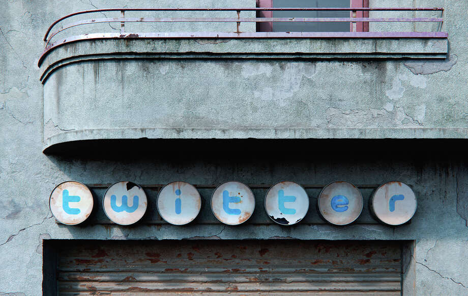 A Romanian artist has reinterpreted the logos for Facebook, Twitter, and Pinterest as distressed signs in a post-apocalyptic world. Photo:  Lacatusu Andrei