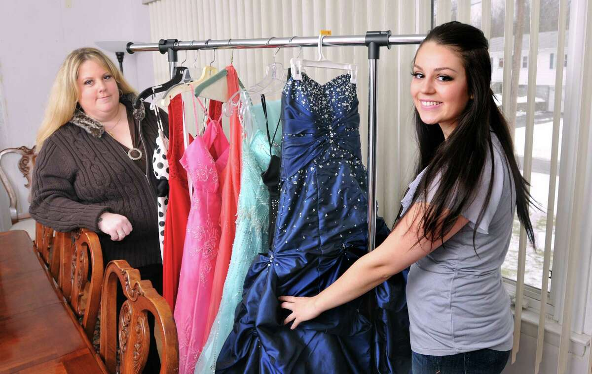 West Haven-- Christina and her mother, Penny Carew, are collecting prom gowns to help high school girls who can't afford the high prices of buying gowns. Photo by Peter Casolino/New Haven Register 12/29/10 Cas101229
