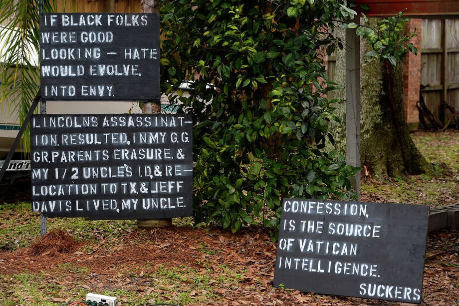 Signs commenting on race, the Catholic Church and the assassination of President Abraham Lincoln outside of a home on Taft Avenue in Groves.  Photo taken Monday 1/8/18 Ryan Pelham/The Enterprise Photo: Ryan Pelham / ©2017 The Beaumont Enterprise/Ryan Pelham