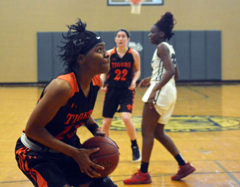 Edwardsville senior Myriah Noodel-Haywood goes up for two of her 18 points she scored Saturday against Whitfield at the St. Joseph's Shootout.