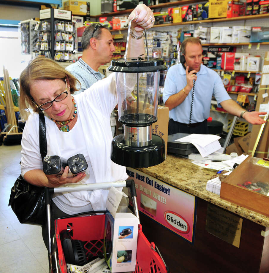 Brad Horrigan | New Haven Register.  BH0660. East Haven, Connecticut - With Hurricane Earl approaching the east coast, Ginny Wexler, of Branford, purchases among other things, 6-volt batteries for her battery-powered lantern at Goody's Hardware Store Thursday.
