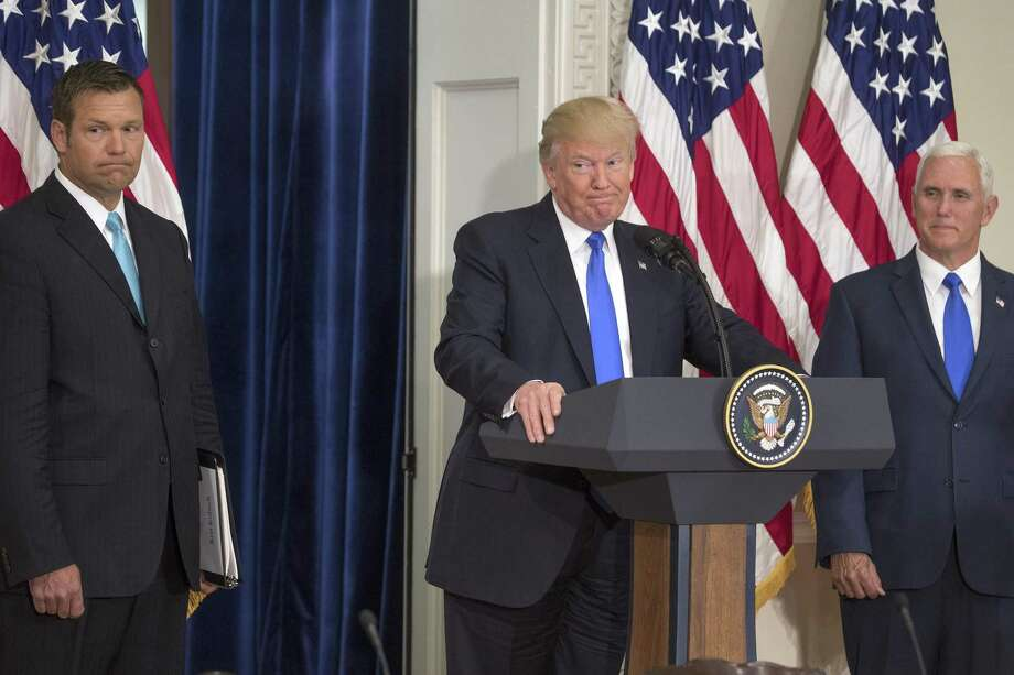 President Donald Trump speaks, as Kansas Secretary of State Kris Kobach, left, and Vice President Mike Pence, look on, during the first meeting of the Presidential Advisory Commission on Election Integrity, July 19. On Wednesday, Trump abruptly shut down the panel, ending a brief quest for evidence of election theft that generated lawsuits, outrage and some scholarly testimony, but no real evidence that American elections are corrupt. Photo: STEPHEN CROWLEY /NYT / NYTNS