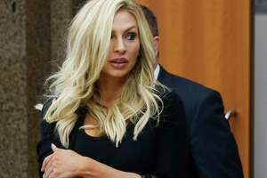 Lindy Lou Layman walks out of court Tuesday, Jan. 9, 2018 in Houston. Layman is accused of destroying at least $300,000 worth of sculptures and original paintings - including two original Andy Warhol works - at the River Oaks home of Houston trial lawyer Anthony Buzbee.