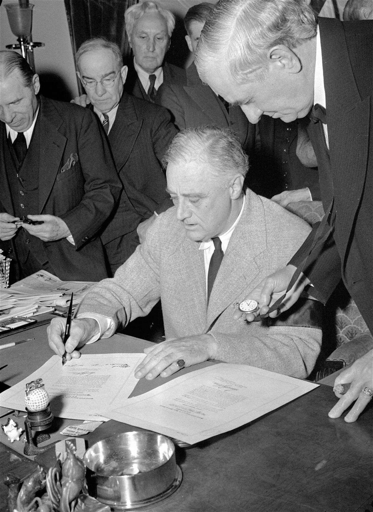 President Franklin Roosevelt signing declaration of war against Germany at the White House December 11, 1941 at 3:08 p.m. EST. From left to right: Rep. Sol Bloom; Rep. Luther Johnson; Rep. John Eaton; President Roosevelt; and Sen. Tom Connally. (AP Photo)