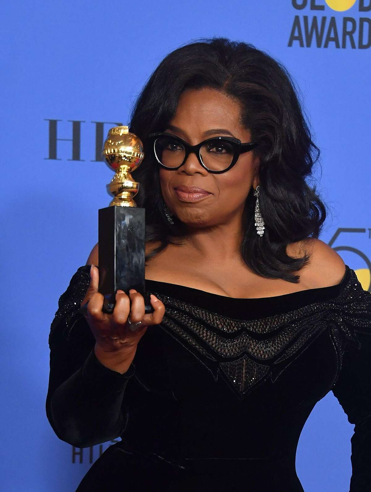 TOPSHOT - Actress and TV talk show host Oprah Winfrey poses with the Cecil B. DeMille Award during the 75th Golden Globe Awards on January 7, 2018, in Beverly Hills, California. / AFP PHOTO / Frederic J. BROWNFREDERIC J. BROWN/AFP/Getty Images