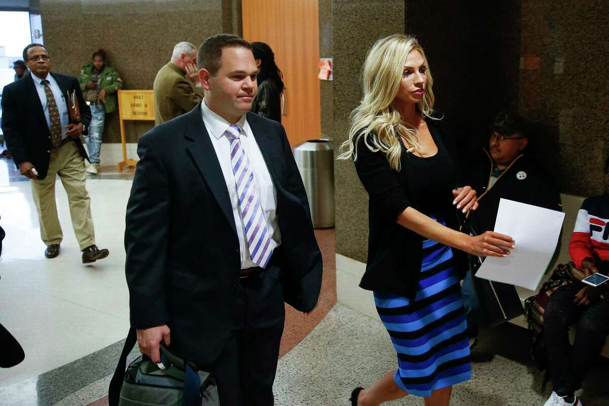 Lindy Lou Layman stands with her defense attorney, Justin Keiter, after making an appearance in court Tuesday, Jan. 9, 2018 in Houston. Layman is accused of destroying at least $300,000 worth of sculptures and original paintings - including two original Andy Warhol works - at the River Oaks home of Houston trial lawyer Anthony Buzbee.