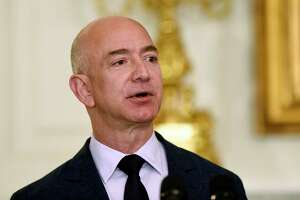 """Jeff Bezos, the founder and CEO of Amazon.com, speaks in the State Dining Room of the White House in Washington. """"During the campaign Trump said Amazon was getting 'away with murder taxwise,' """" Wolff writes."""