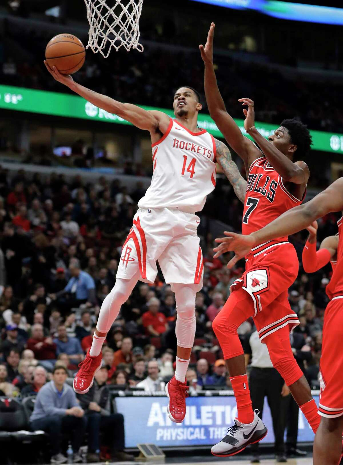Houston Rockets' Gerald Green (14) scores past Chicago Bulls' Justin Holiday (7) during the first half of an NBA basketball game Monday, Jan. 8, 2018, in Chicago. (AP Photo/Charles Rex Arbogast)
