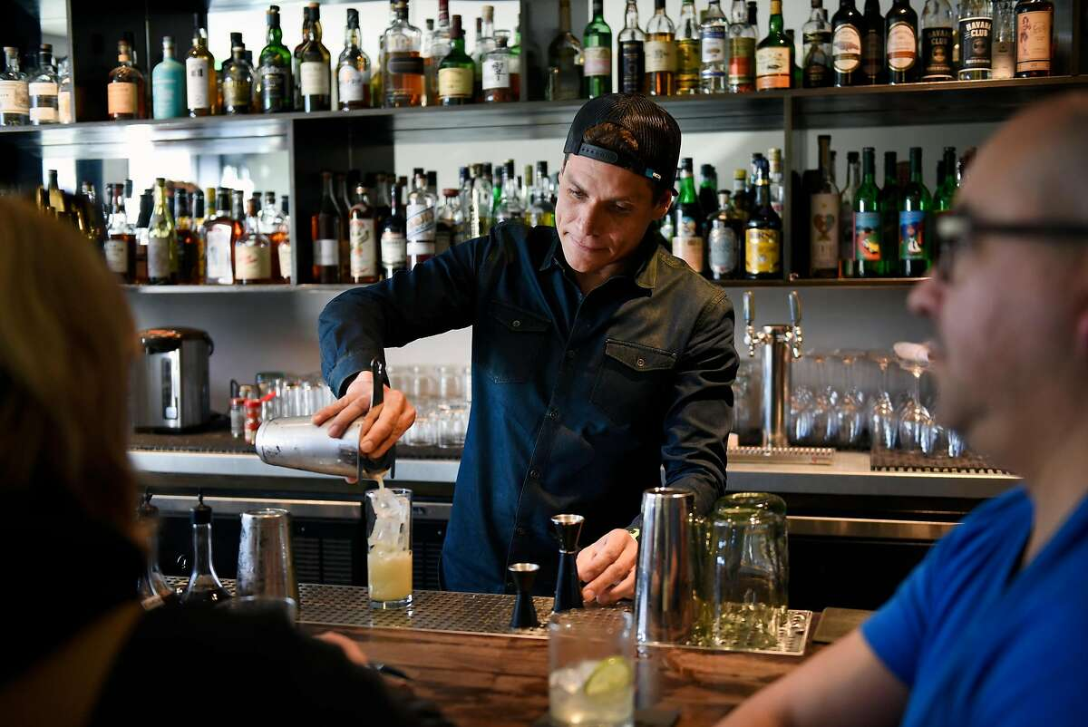 Head bartender Carlos Yturria pours a drink at the White Cap cocktail bar in San Francisco, Calif., on Saturday January 6, 2018.