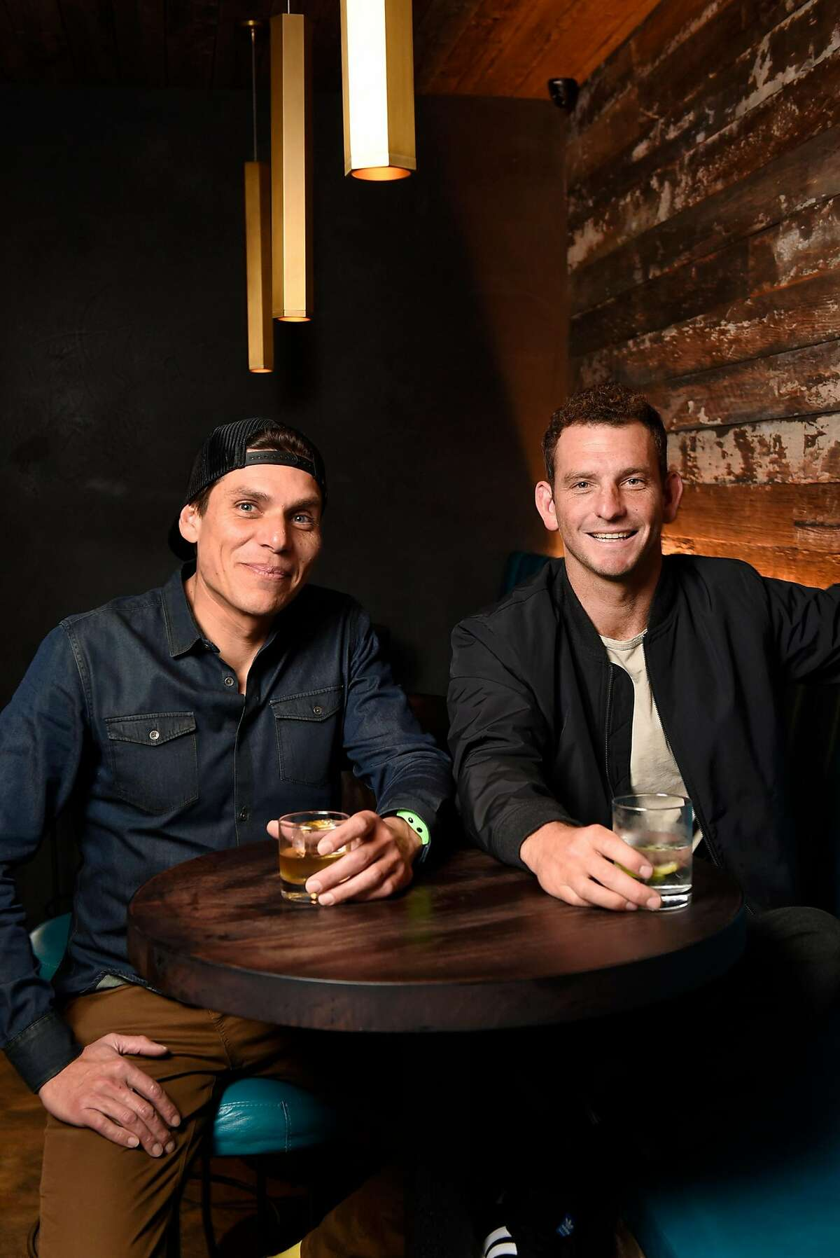 Head bartender Carlos Yturria, left, and owner Matt Lopez sit for a portrait at the White Cap cocktail bar in San Francisco, Calif., on Saturday January 6, 2018.