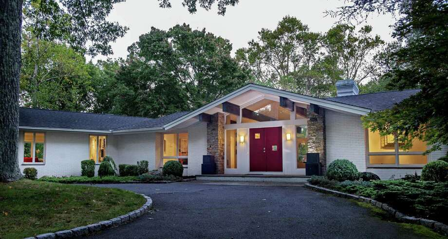 The white brick contemporary house at 153 Proprietors Crossing was inspired by New Canaan's legacy of mid-century moderns.