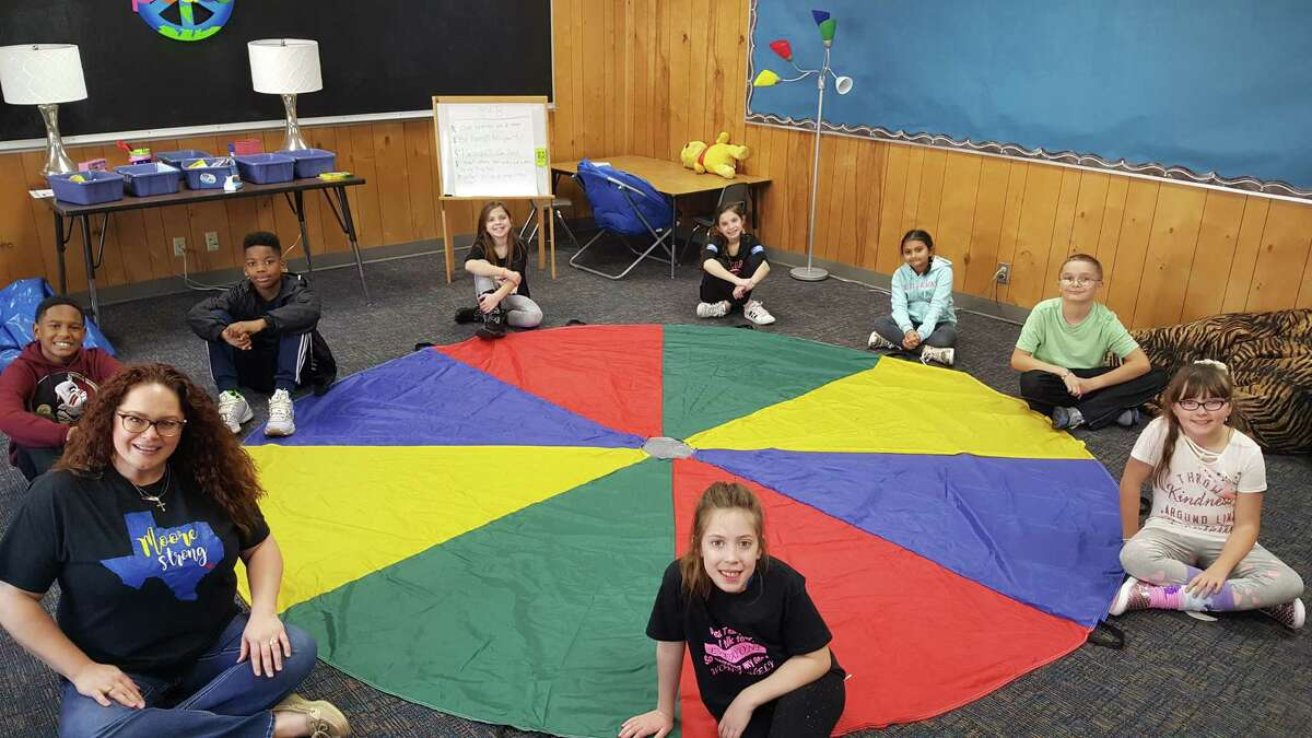Moore Elementary counselor Jennifer D. Nichols has been meeting with students from grades 2-5 in post-Hurricane Harvey small group settings to help them deal with everyday emotions. Using the parachute is among their favorite activities in the group.
