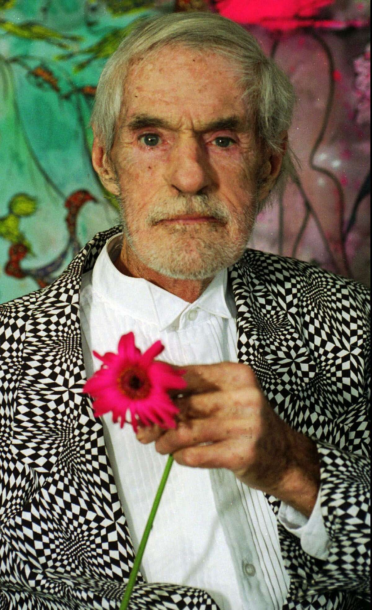 The late Timothy Leary is shown in his Beverly Hills, Calif., home in this Jan. 1996, file photo. The counterculture guru who was an anti-establishment hero in the 1960s, secretly cooperated with the FBI, newly released records indicate. Leary's information identified collaborators in his 1970 escape from a California prison. (AP Photo/Walt Weis, File)