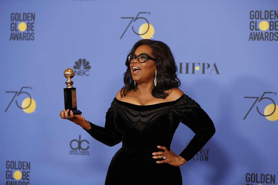 Oprah Winfrey received the Cecil B. DeMille Award at the Golden Globes in Beverly Hills. Photo: Allen J. Schaben, TNS