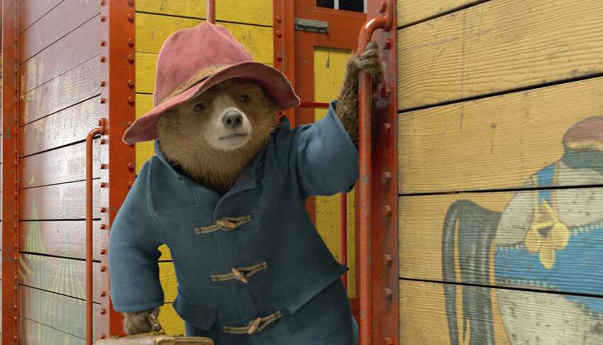 This image released by Warner Bros. Pictures shows the character Paddington, voiced by Ben Whishaw, in a scene from