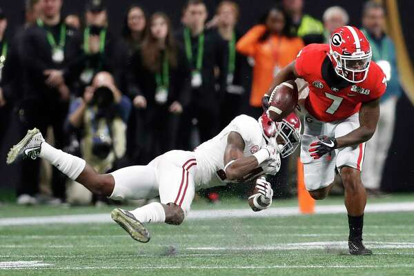 Georgia running back D'Andre Swift gets past Alabama's Deionte Thompson during the first half of the NCAA college football playoff championship game Monday, Jan. 8, 2018, in Atlanta. (AP Photo/David Goldman)