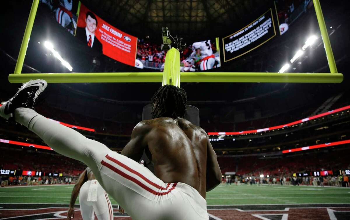 Alabama's Tony Brown warms up before the NCAA college football playoff championship game against Georgia, Monday, Jan. 8, 2018, in Atlanta. (AP Photo/David Goldman)