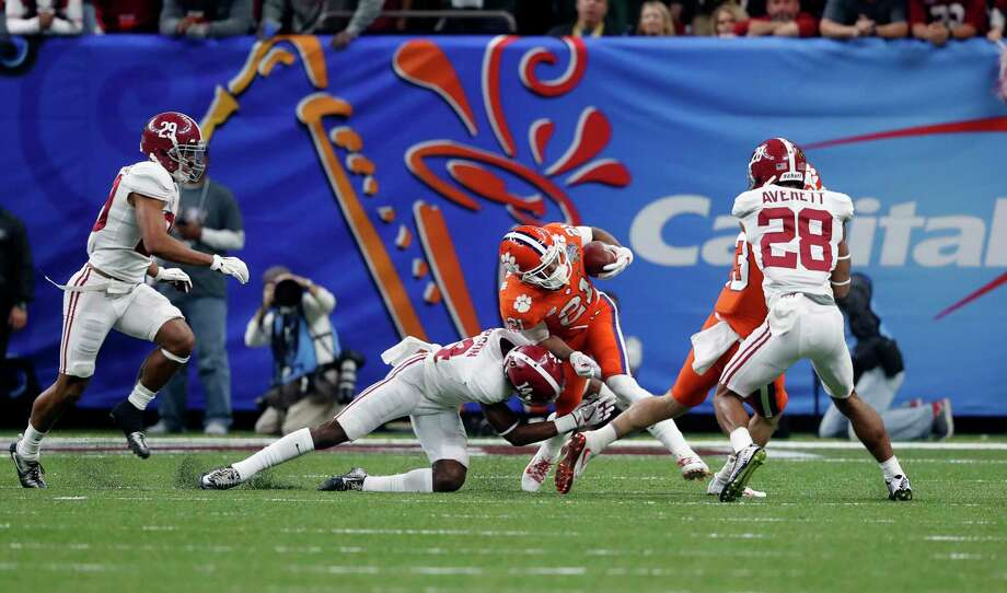 Clemson wide receiver Ray-Ray McCloud (21) is hit by Alabama defensive back Deionte Thompson (14) in the first half of the Sugar Bowl semi-final playoff game for the NCAA college football national championship, in New Orleans, Monday, Jan. 1, 2018. (AP Photo/Gerald Herbert) Photo: Gerald Herbert, Associated Press / Copyright 2018 The Associated Press. All rights reserved.