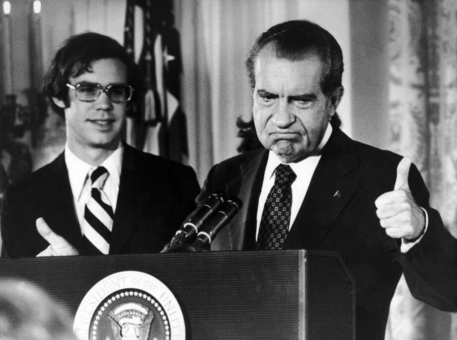 Richard Nixon bids goodbye to the personnel of the White House, standing with his son-in-law David Eisenhower Aug. 12, 1974. Photo: Keystone-France / Gamma-Keystone Via Getty Images / 1974 Keystone-France Photo by Keystone-France/Gamma-Keystone via Getty Images