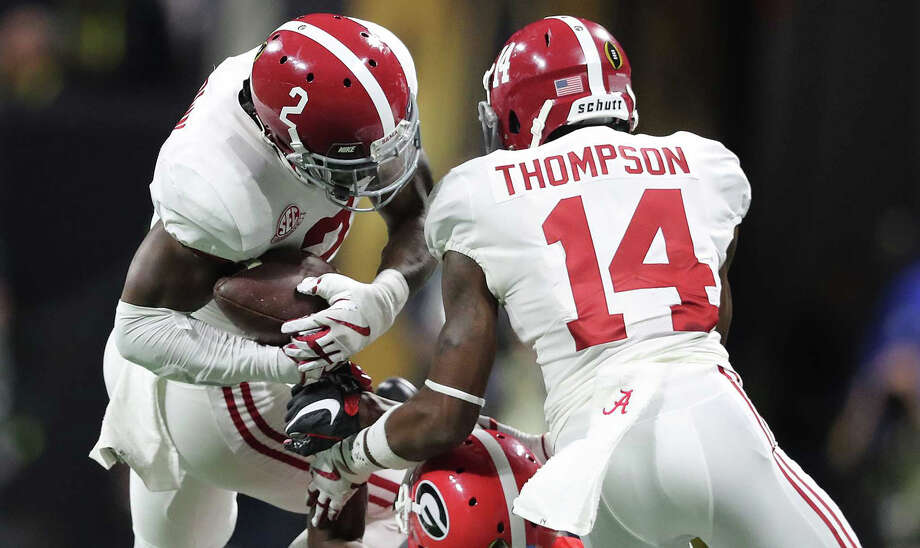 Alabama's Tony Brown intercepts a Nick Fromm pass to Javon Wimms on the opening drive during the first quarter in the College Football Playoff National Championship at Mercedes-Benz Stadium on Monday, Jan. 8, 2018 in Atlant, Ga.