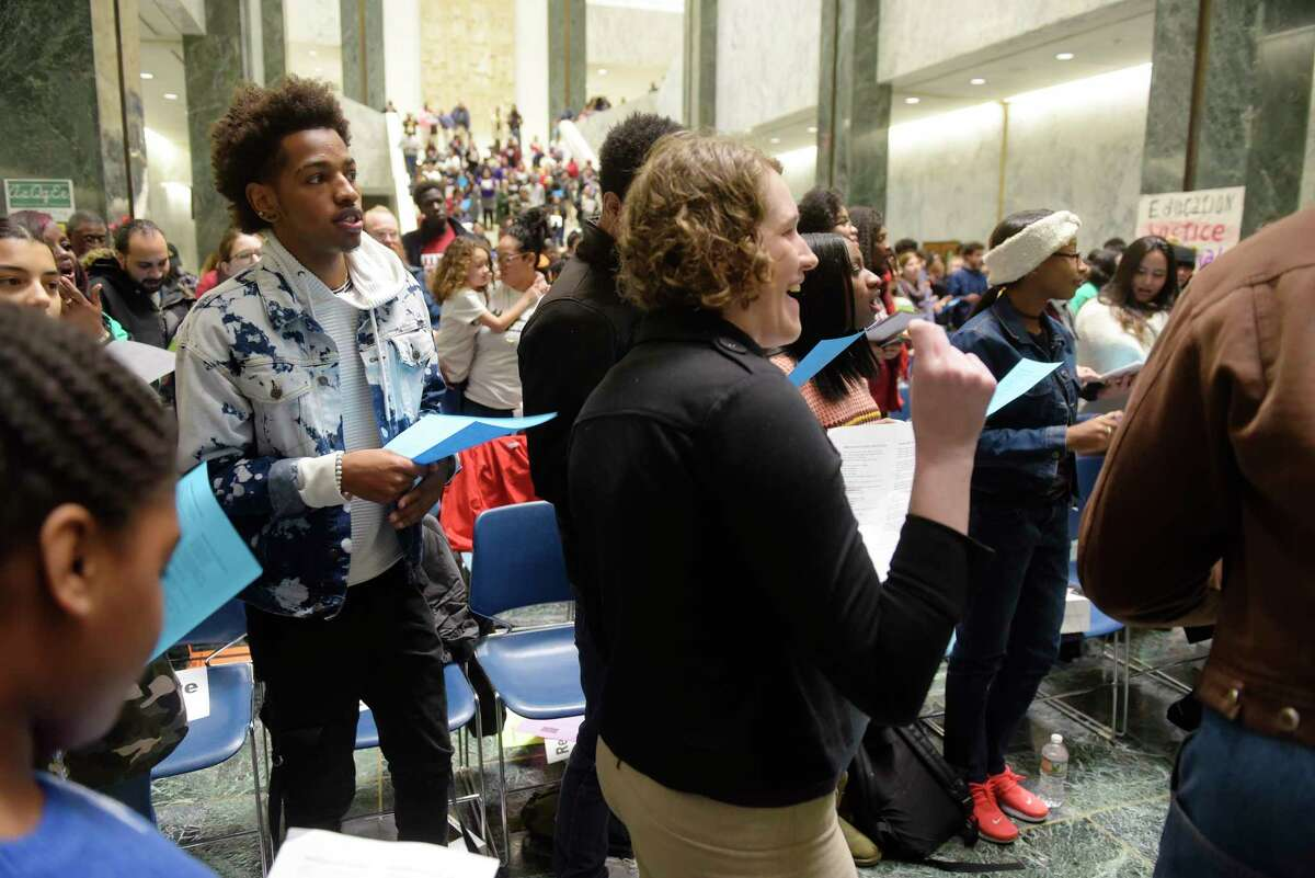 Public school students, parents and community members take part in an rally at the Legislative Office Building on Tuesday, Jan. 9, 2018, in Albany, N.Y. The children and adults held the rally to call for racial and economic equity in New York's education system. (Paul Buckowski / Times Union)