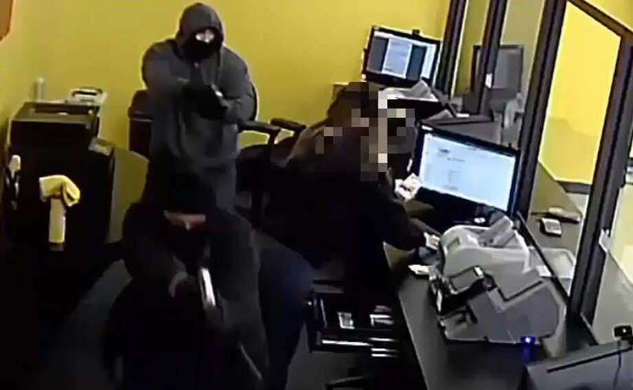 Surveillance video was released showing two men robbing the 1% Check Cashing location at 920 East Little York on Jan. 5.
