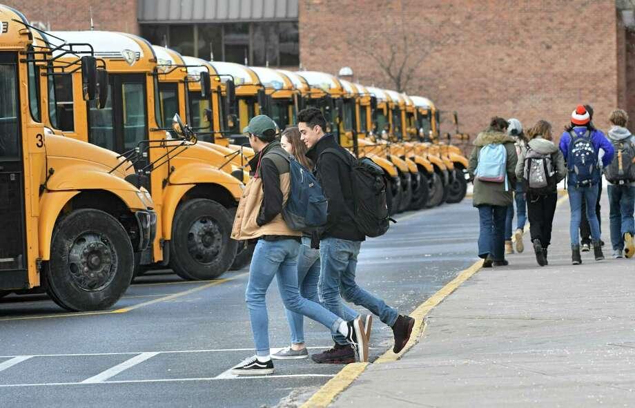 School buses pick up students at Saratoga High School on Tuesday Jan. 9, 2018 in Saratoga Springs, N.Y. (Lori Van Buren / Times Union) Photo: Lori Van Buren, Albany Times Union / 20042618A