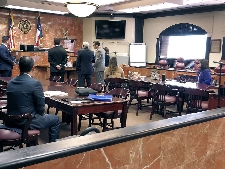 Webb County District Clerk Esther Degollado and her lawyers appear at the 406th District Court on Monday for a hearing regarding a temporary restraining order that she requested be filed against her political opponent, Jackie Leven-Ramos. Photo: Cuate Santos/Laredo Morning Times