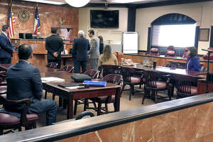 Webb County District Clerk Esther Degollado and her lawyers appear at the 406th District Court on Monday for a hearing regarding a temporary restraining order that she requested be filed against her political opponent, Jackie Leven-Ramos.