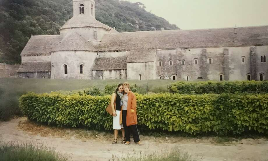 "Mary-Lou Weisman and her goddaughter, Zoe, pose in front of the Abbaye de Senanque in Provence, France. Zoe played what the author calls a ""cameo role"" in the book, ""Playing House in Provence."" Photo: Mary-Lou Weisman / Contributed Photo"