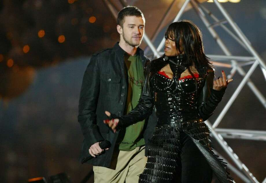 """15) Janet Jackson's Wardrobe Malfunction Some other things probably happened at the 2004 Super Bowl, but the only thing they'll be writing about in the history books is that infamous halftime show. When Justin Timberlake ripped off a piece of Janet Jackson's bustier, her bare breast — albeit adorned with a nipple shield — was shown to the entire world. The NFL and the FCC were real mad (540,000 people filed complaints), and it ignited a national conversation about the supposed end of morality in America. Jackson's career never really recovered — while Timberlake, who failed to come to Jackson's defense, got off scot-free — but the scandal did gift us with the now-commonplace term of """"wardrobe malfunction.""""  Photo: Getty Images"""