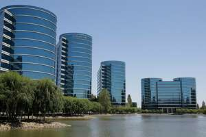 FILE - This June 18, 2012 file photo, shoes the Oracle headquarters in Redwood City, Calif.  Oracle founder Larry Ellison already owns an island in Hawaii. Now, his company is building a high school next to its Silicon Valley headquarters to help fulfill Ellison's desire to teach students more about technology and problem-solving. The plan unveiled Tuesday, Oct. 27, 2015, at an Oracle customer conference calls for the business software maker to complete the 64,000-square-foot school by August 2017. (AP Photo/Paul Sakuma, File)