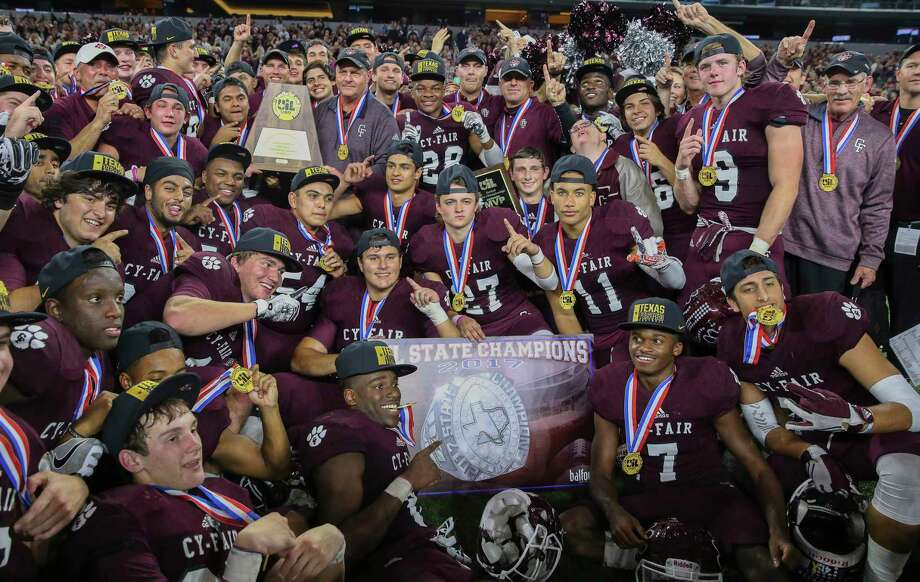 Cy-Fair coaches and players pose for a photo with the state title plaque after winning the Class 6A Division II State Championship Game at AT&T Stadium on Saturday, Dec. 23, 2017, in Arlington. The Cy-Fair Bobcats defeated the Waco Midway Panthers 51-35 and won the state championship title. Photo: Yi-Chin Lee, Houston Chronicle / © 2017  Houston Chronicle