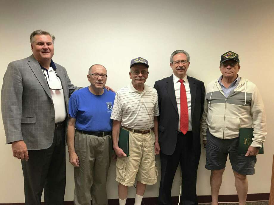 From left to right: Mark Halliday, Assisted Living Services/Assisted Living Technologies Community Liaison; veterans Bob Boucher and Roberto Gagliardi of Wallingford; Attorney Henry Weatherby, and veteran Bob Fortino of North Branford, at the monthly Veteran's Coffee House at the Wallingford Senior Center in August. The next gathering is scheduled for Jan. 23.. Photo: By Register Staff