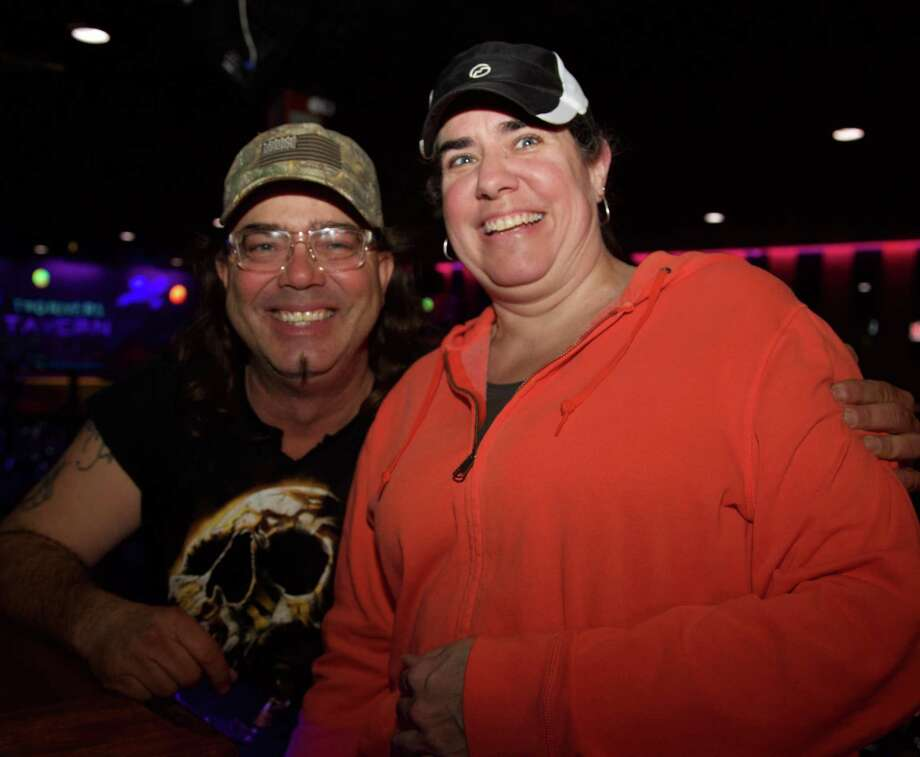 Scott Wayne and Darla Crawford have fun at Two Rivers Tavern. Photo: Xelina Flores /For The Express-News