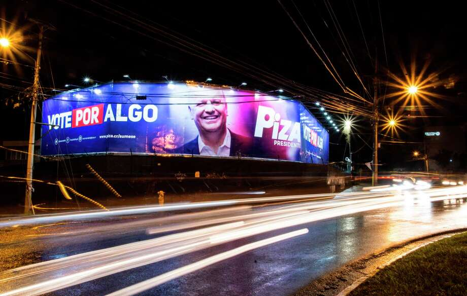 In San Jose, a campaign banner depicting Costa Rican presidential candidate Rodolfo Piza of the Social Christian Unity Party (PUSC). In a climate of uncertainty, Costa Ricans will go to the polls on February 4. Nearly half the population remains undecided. Photo: EZEQUIEL BECERRA, AFP/Getty Images / AFP or licensors