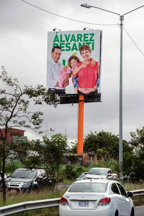 An election campaign banner shows Costa Rican presidential candidate Antonio Alvarez Desanti of the National Liberation Party (PLN) with his wife grandchildren. Photo: EZEQUIEL BECERRA, AFP/Getty Images / AFP or licensors