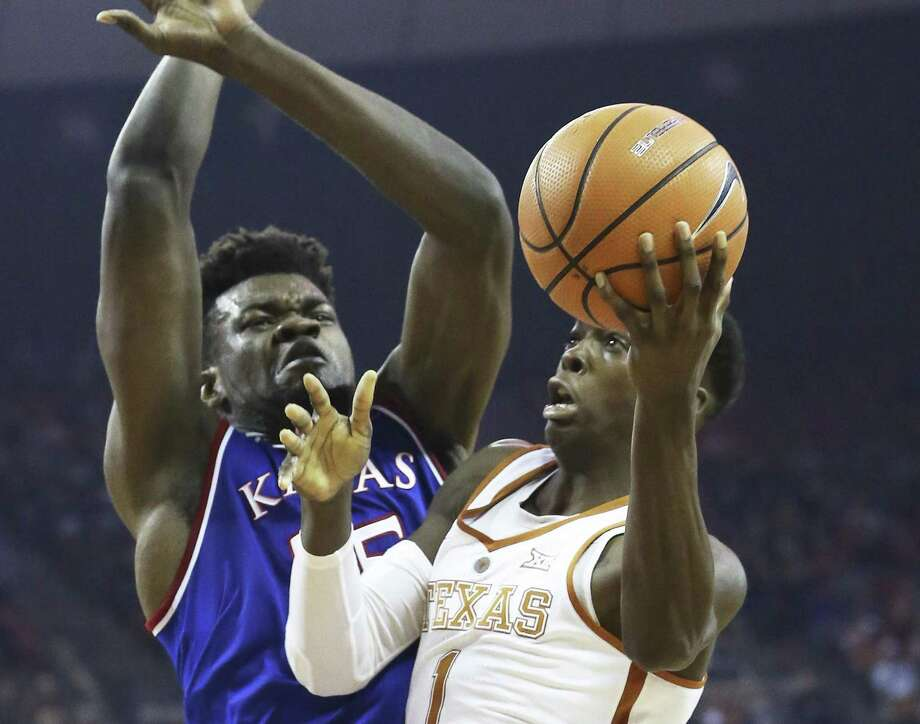 Horns guard Andrew Jones gets past Udoka Azubuike for a layup as Texas hosts Kansas at the Erwin Center on Dec. 29. Jones hasn't suited up for the Longhorns since due to an undisclosed illness. Photo: Tom Reel /San Antonio Express-News / 2017 SAN ANTONIO EXPRESS-NEWS
