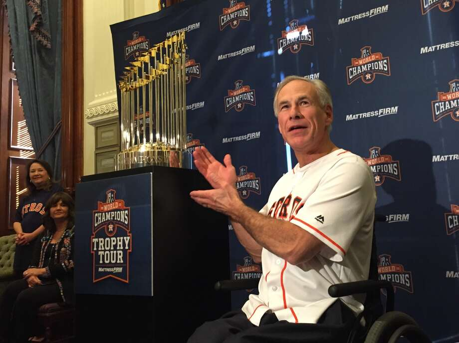 Gov. Greg Abbott hosts the Astros' 2017 World Championship trophy in his Austin office as hundreds of people line up to take their picture with the 30-pound statue. Photo: Andrea Zelinski, Houston Chronicle