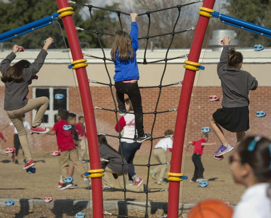 Students at Bowie Elementary play on playground equipment and run around 12/19/17. Tim Fischer/Reporter-Telegram Photo: Tim Fischer/Midland Reporter-Telegram