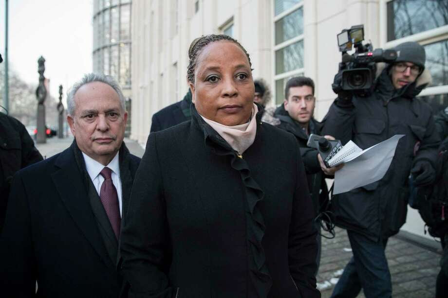 Pamela Harris, center, is pursued by reporters as she leaves Brooklyn Federal court with attorney, Jerry H. Goldfeder, Tuesday, Jan. 9, 2018, in New York. The New York state assemblywoman from Brooklyn was arrested Tuesday after authorities said she carried out several frauds, including claiming Superstorm Sandy forced her from her home, before spending the proceeds of the crimes on things like her mortgage, airline and cruise expenses, and Victoria's Secret. Photo: Mary Altaffer, AP / Copyright 2018 The Associated Press. All rights reserved.