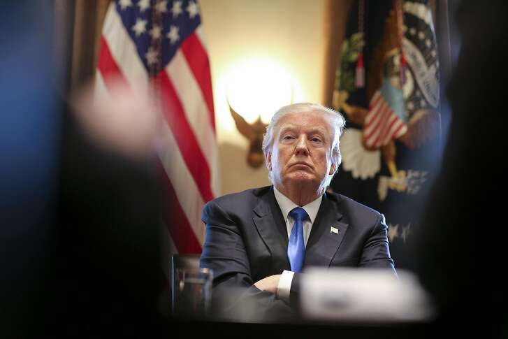 President Donald Trump listens during a meeting with legislators on immigration reform in the Cabinet Room of the White House on January 9, 2018 in Washington, DC. (Oliver Contreras/SIPA USA)