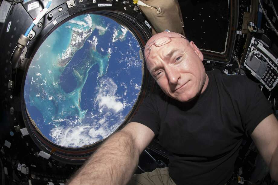 In this July 12, 2015 photo, Astronaut Scott Kelly takes a photo of himself inside the Cupola, a special module of the International Space Station which provides a 360-degree viewing of the Earth and the station. Photo: Scott Kelly/NASA Via AP