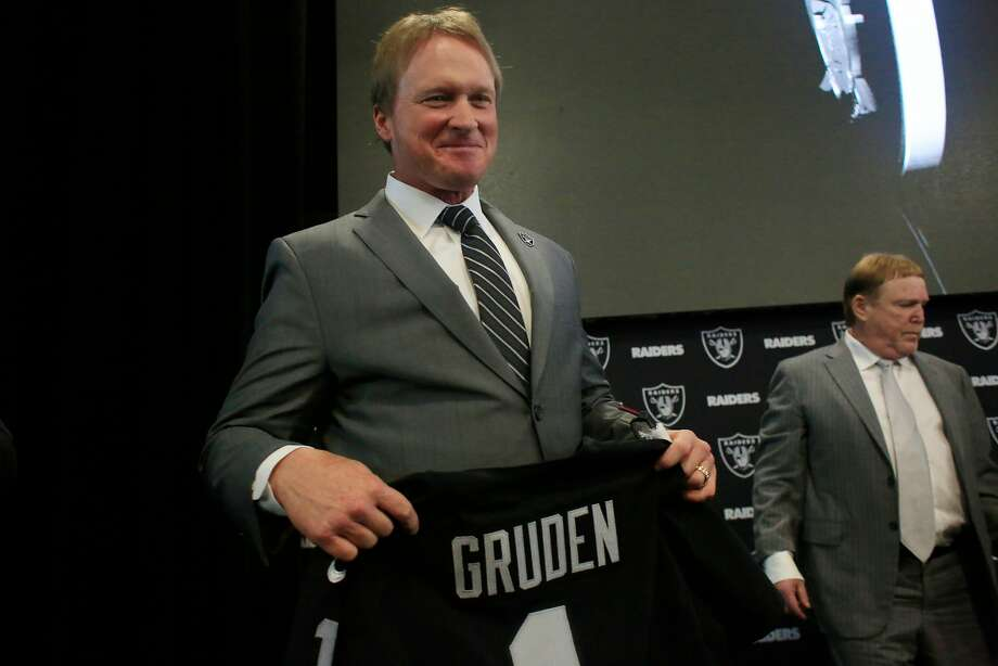 Jon Gruden (l to r), Oakland Raiders head coach, holds a Oakland Raiders jersey with his name as he stands next to owner Mark Davis after being introduced as the new head coach of the Oakland Raiders during a news conference at Raiders Headquarters on Tuesday, January 9, 2018 in Alameda.The NFL announced Friday it found the Raiders complied with the Rooney Rule in the hiring of head coach Jon Gruden. Photo: Lea Suzuki, The Chronicle