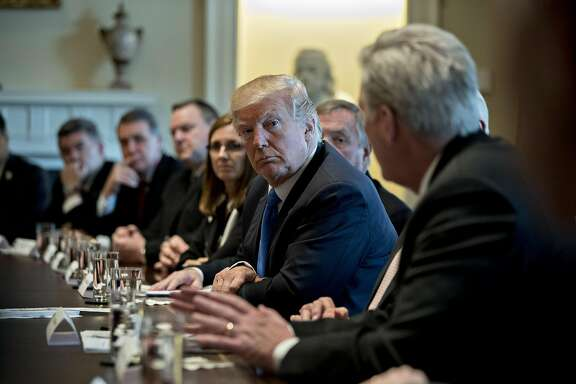 U.S. President Donald Trump, center, listens while House Majority Leader Kevin McCarthy, a Republican from California, right, speaks during a meeting with bipartisan members of Congress on immigration in the Cabinet Room of the White House in Washington, D.C., U.S., on Tuesday, Jan. 9, 2018. Trump�indicated he's willing to split contentious immigration proposals into two stages, providing protections for young immigrants known as dreamers and increasing border security first, leaving tougher negotiations on comprehensive legislation for later. Photographer: Andrew Harrer/Bloomberg