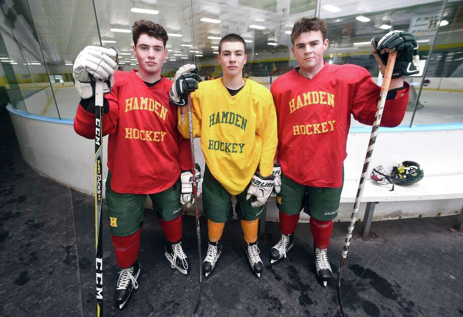 The Gethings brothers, left to right, Michael, Conor and John have led the Hamden ice hockey team to a 4-2 start this season. Photo: Arnold Gold / Hearst Connecticut Media / New Haven Register