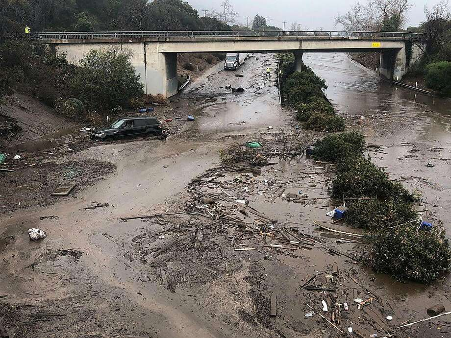 In a Santa Barbara County Fire Department photo, mud and debris fill the  Olive Mill Road underpass on U.S. 101 from flooding on Montecito Creek in Montecito, Calif., Jan. 9, 2018. Drenching rain sent mud roaring down the hillsides of Santa Barbara County on Tuesday, killing at least five people, carrying houses off their foundations, snapping telephone poles and wrapping vehicles around trees, the authorities said. Photo: Mike Eliason, Santa Barbara County Fire Department