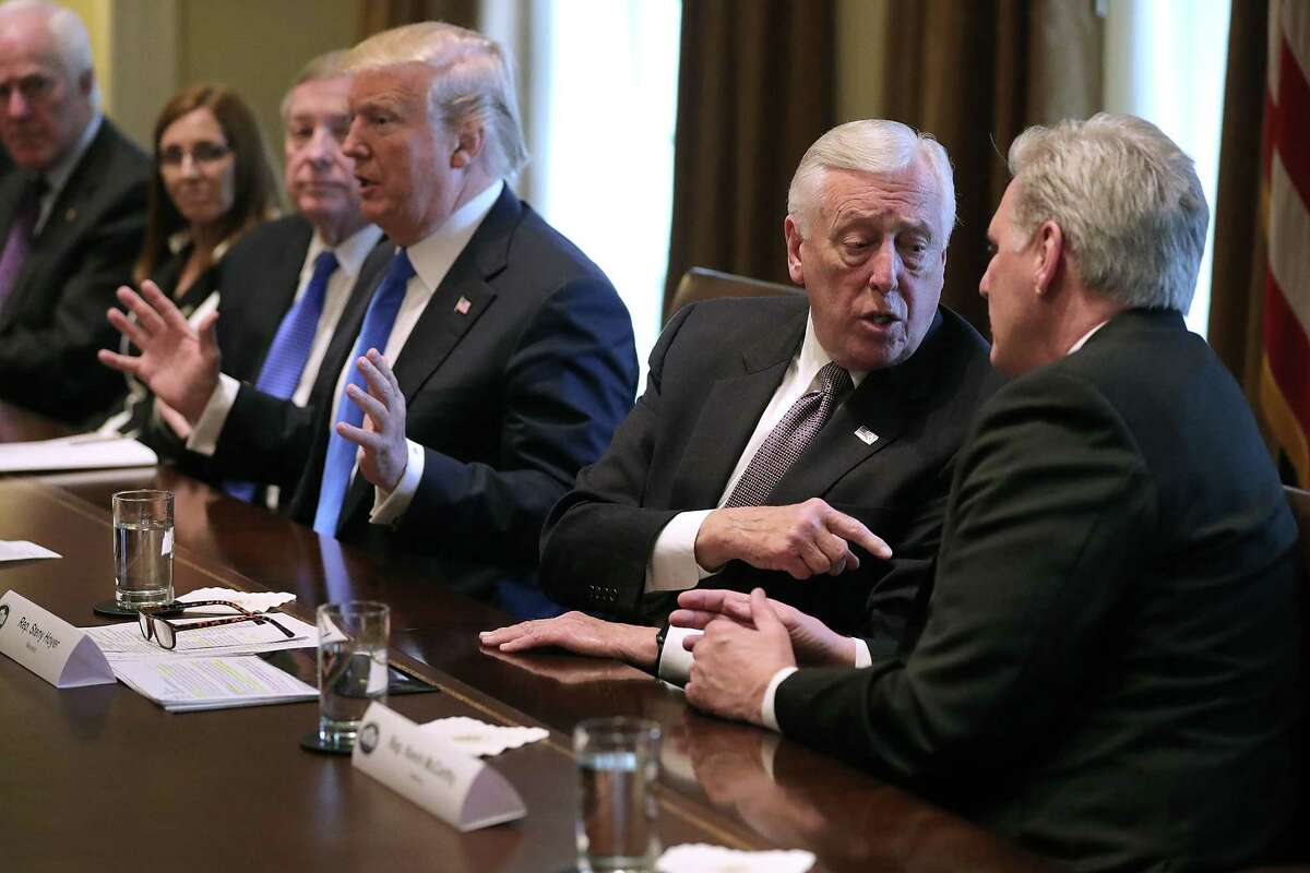 WASHINGTON, DC - JANUARY 09: House Majority Leader Kevin McCarthy (R-CA) (R) and House Minority Whip Steny Hoyer (D-MD) debate as U.S. President Donald Trump presides over a meeting about immigration with Republican and Democrat members of Congress in the Cabinet Room at the White House January 9, 2018 in Washington, DC. In addition to seeking bipartisan solutions to immigration reform, Trump advocated for the reintroduction of earmarks as a way to break the legislative stalemate in Congress.