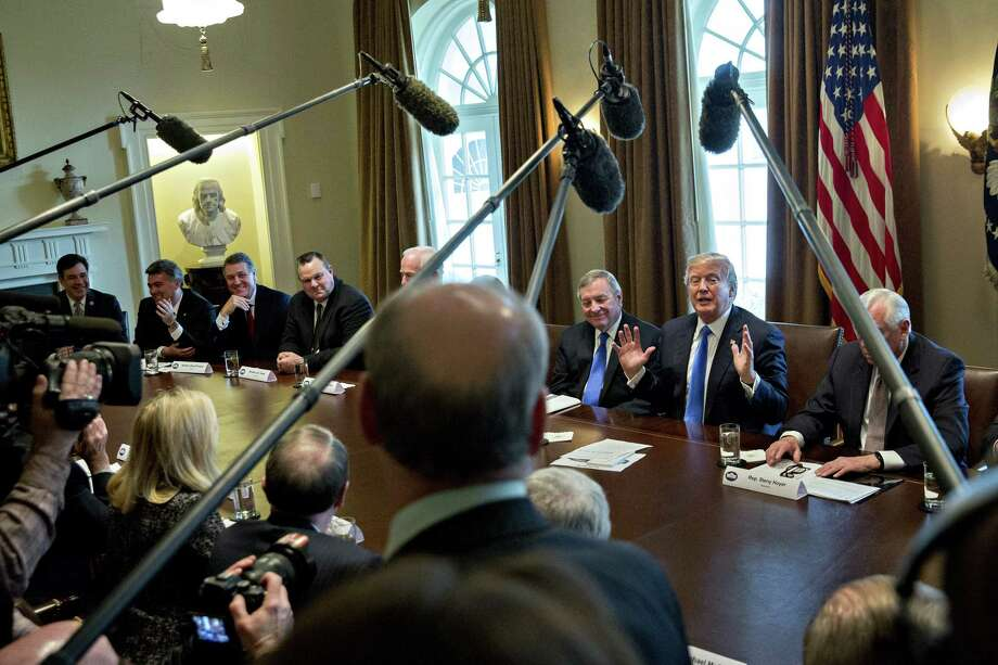 U.S. President Donald Trump, center left, speaks during a meeting with bipartisan members of Congress on immigration in the Cabinet Room of the White House in Washington, D.C., U.S., on Tuesday, Jan. 9, 2018. Trumpindicated he's willing to split contentious immigration proposals into two stages, providing protections for young immigrants known as dreamers and increasing border security first, leaving tougher negotiations on comprehensive legislation for later. Photographer: Andrew Harrer/Bloomberg Photo: Andrew Harrer, Bloomberg / © 2018 Bloomberg Finance LP