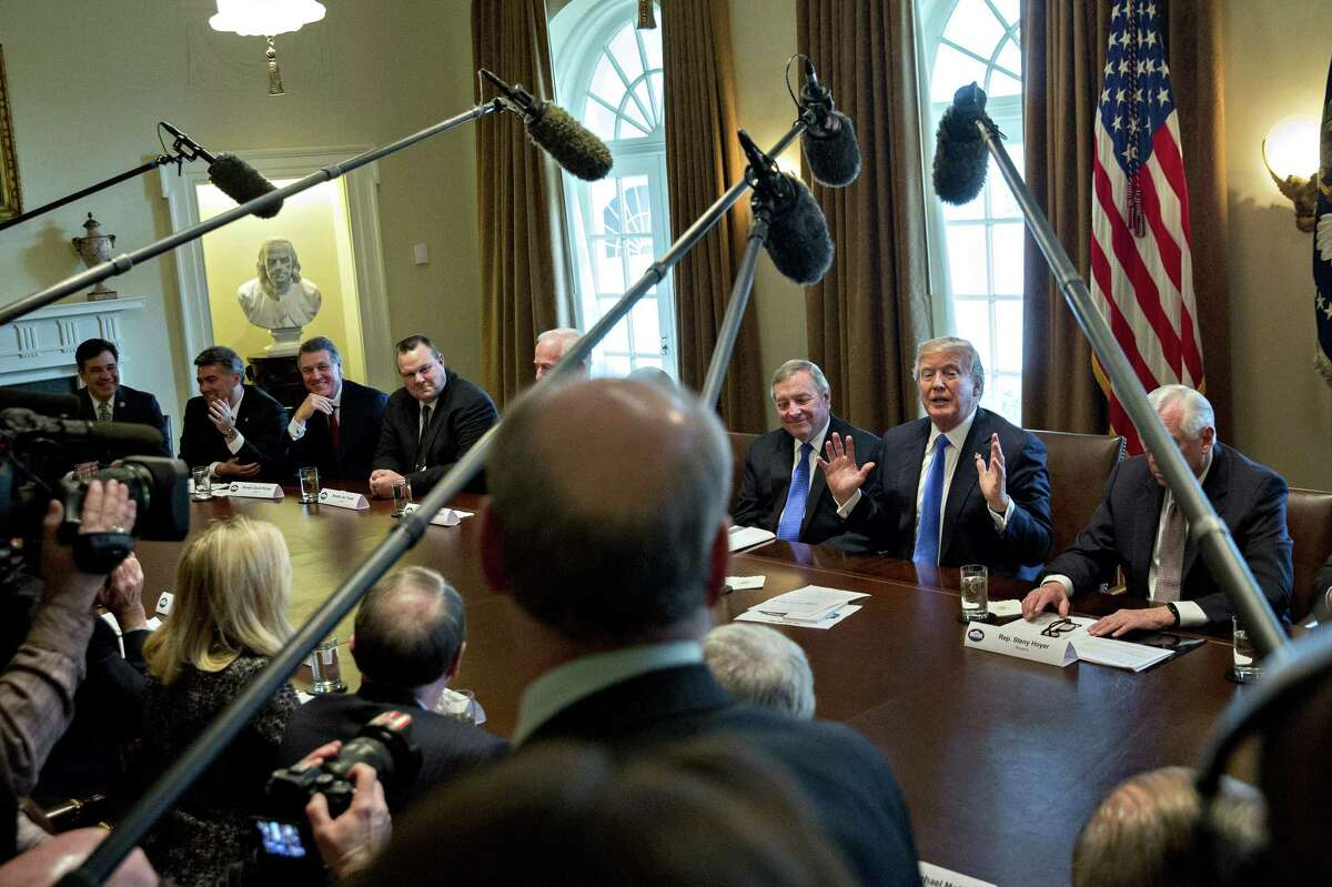 U.S. President Donald Trump, center left, speaks during a meeting with bipartisan members of Congress on immigration in the Cabinet Room of the White House in Washington, D.C., U.S., on Tuesday, Jan. 9, 2018. Trumpindicated he's willing to split contentious immigration proposals into two stages, providing protections for young immigrants known as dreamers and increasing border security first, leaving tougher negotiations on comprehensive legislation for later. Photographer: Andrew Harrer/Bloomberg